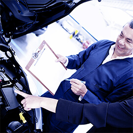 Mechanic Checking Details With Client